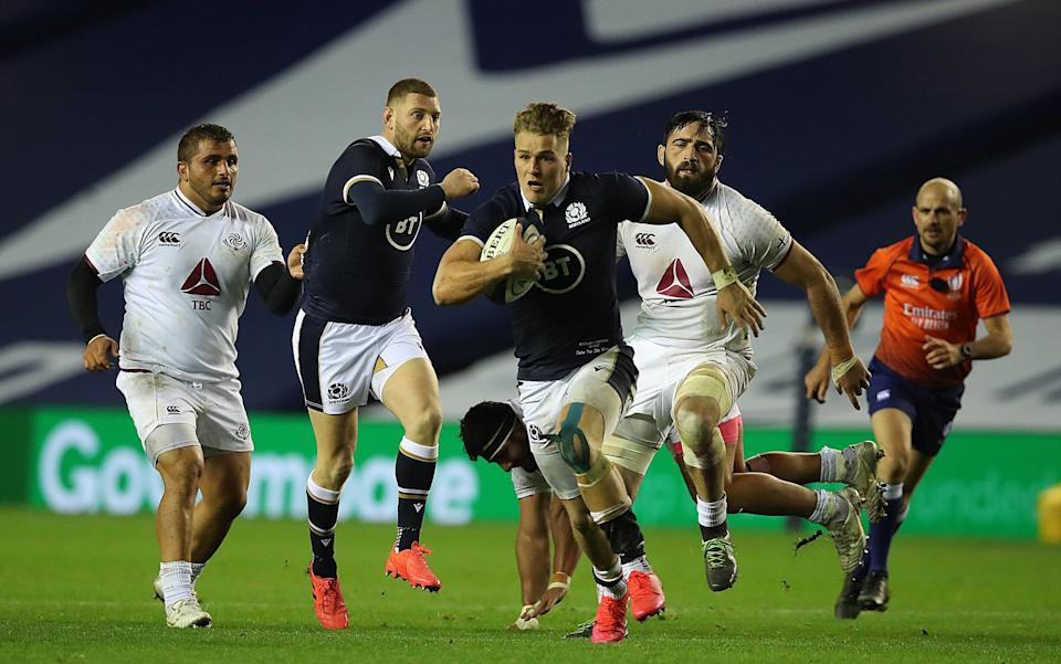 Duhan van der Merwe of Scotland makes a break to score his sides 5th try after being fed a pass from Finn Russell during their side's 45-7 win over Georgia - GETTY IMAGES