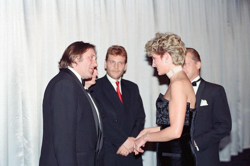 <p>The French actor bid adieu to Princess Diana as she made her way through the receiving line at the premiere of <em>1492. </em>He wore (you guessed it) a black tuxedo. She, on the other hand, chose a black strapless evening gown by Victor Edelstein. </p>