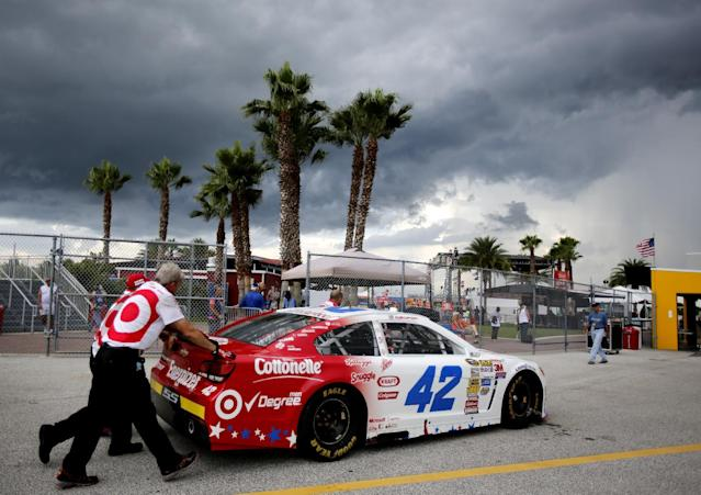 Crew members push Kyle Larson's car to an inspection station after the first NASCAR Sprint Cup practice session at Daytona International Speedway in Daytona Beach, Fla., Thursday, July 3, 2014. Bad weather caused a cancellation of the second practice(AP Photo/Terry Renna)