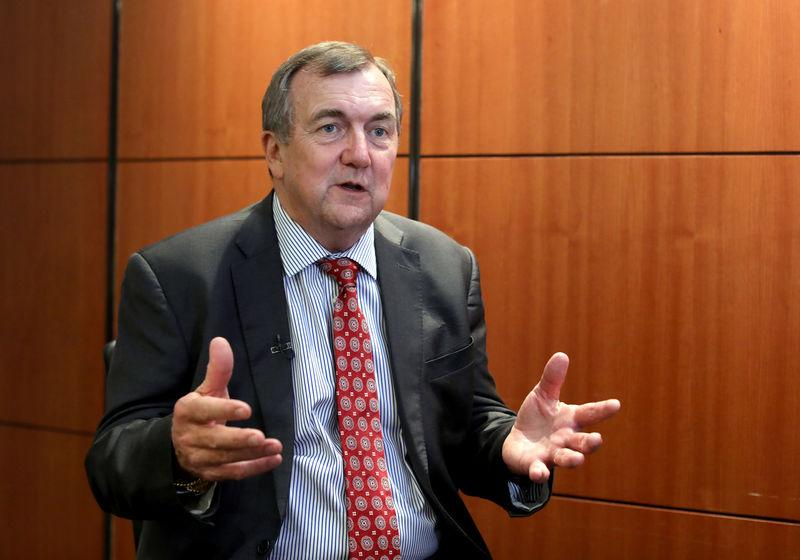 FILE PHOTO: Mark Bristow, chief executive officer of Barrick Gold, speaks during an interview at the Investing in African Mining Indaba conference in Cape Town