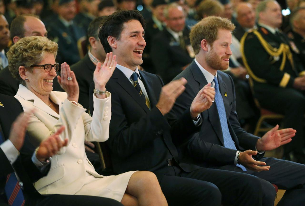 Ontario Premier Kathleen Wynne (L to R), Britain's Prince Harry and Canada's Prime Minister Justin Trudeau react as they listen to a presentation during a Invictus Games media launch in Toronto, Ontario, Canada, May 2, 2016. REUTERS/Mark Blinch