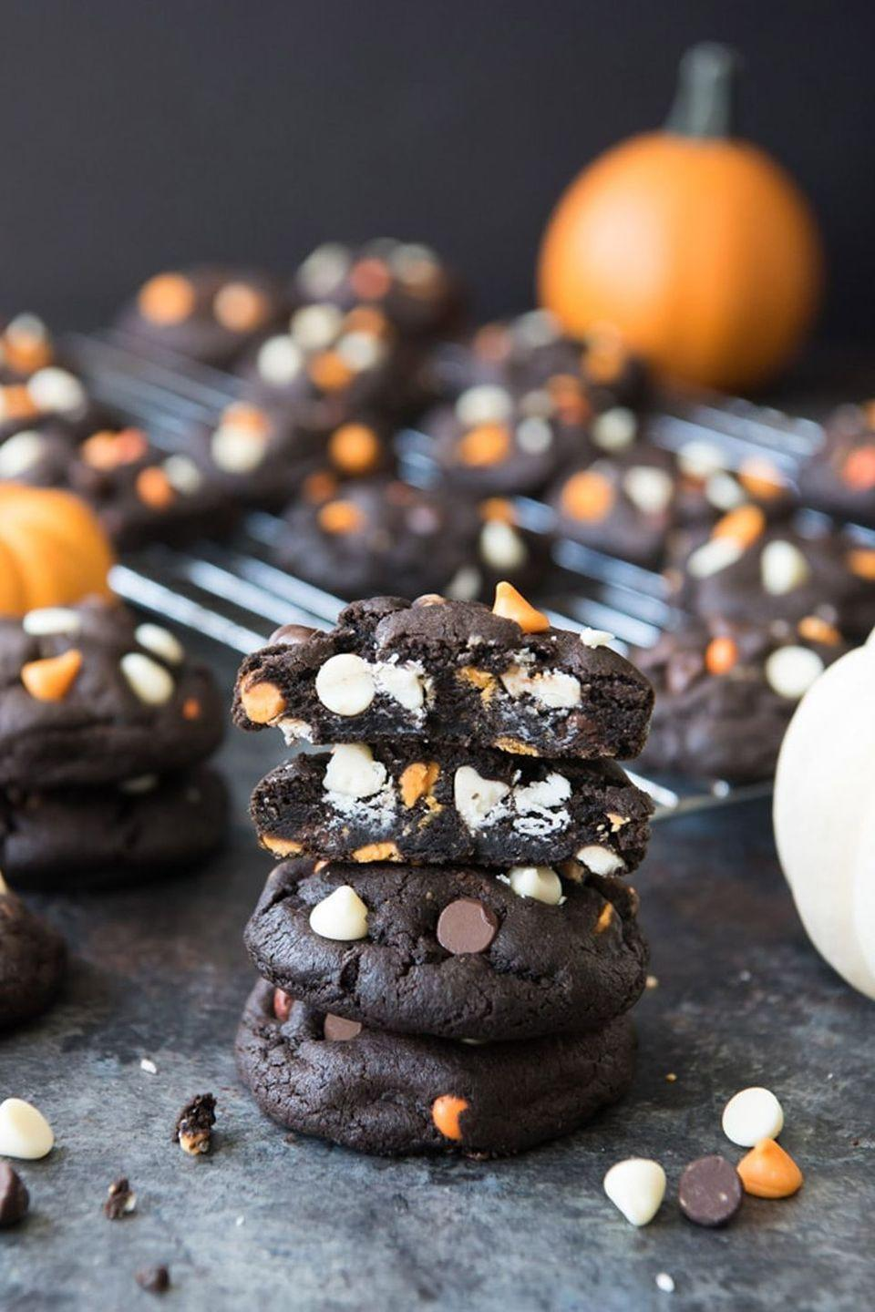 """<p>Loaded with white chocolate and peanut butter chips, these cookies are a seriously decadent way to celebrate the holiday.</p><p><strong>Get the recipe at <a href=""""https://houseofnasheats.com/dark-chocolate-halloween-chip-cookies/"""" rel=""""nofollow noopener"""" target=""""_blank"""" data-ylk=""""slk:House of Nash Eats"""" class=""""link rapid-noclick-resp"""">House of Nash Eats</a>.</strong></p><p><strong><strong><a class=""""link rapid-noclick-resp"""" href=""""https://go.redirectingat.com?id=74968X1596630&url=https%3A%2F%2Fwww.walmart.com%2Fip%2FThe-Pioneer-Woman-Classic-Charm-16-Inch-Rectangular-Platter-Blue%2F975428930&sref=https%3A%2F%2Fwww.thepioneerwoman.com%2Ffood-cooking%2Fmeals-menus%2Fg32110899%2Fbest-halloween-desserts%2F"""" rel=""""nofollow noopener"""" target=""""_blank"""" data-ylk=""""slk:SHOP SERVING PLATTERS"""">SHOP SERVING PLATTERS</a></strong><br></strong></p>"""