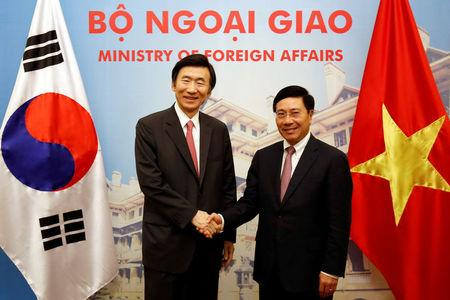 South Korean Foreign Minister Yun Byung-Se is welcomed by Vietnam's Deputy Prime Minister Pham Binh Minh in Hanoi