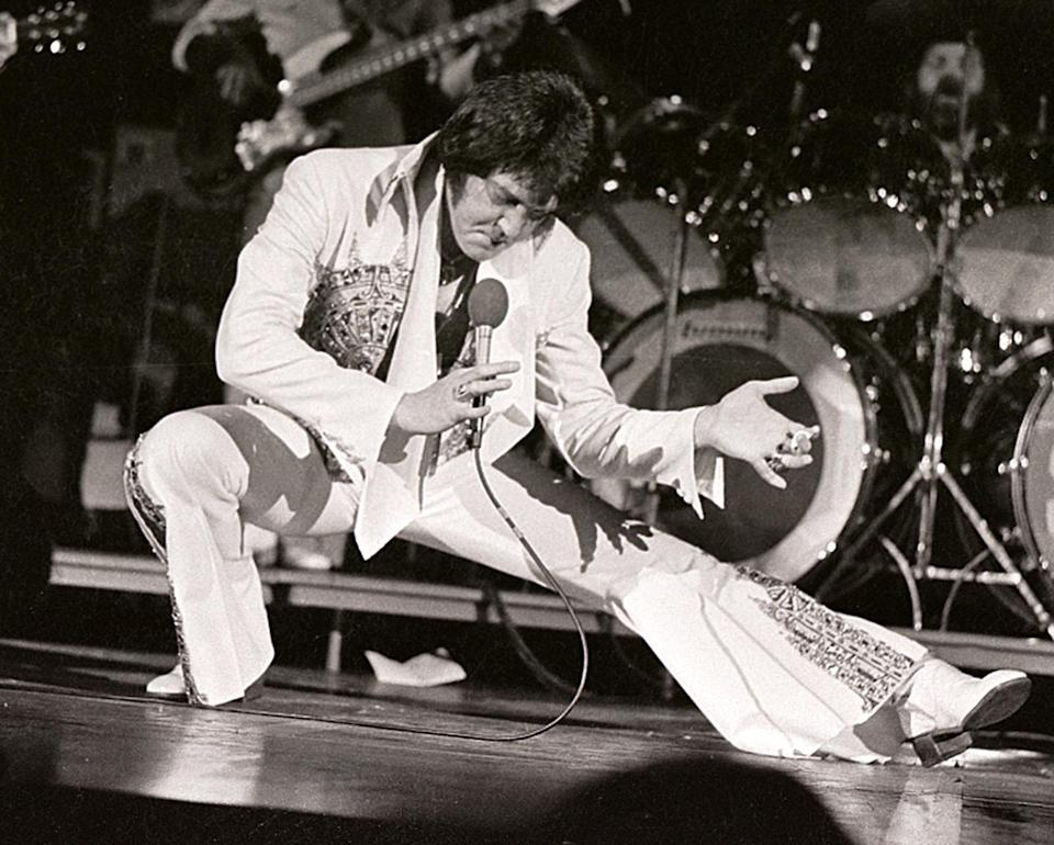 <p>The King of Rock 'n' Roll may also be the king of flared jumpsuits. He wore his signature look at a concert in Milwaukee in 1977. (Photo: Ronald C. Modra/ Getty Images) </p>