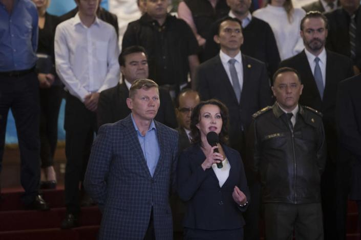 """<div class=""""inline-image__title""""> Guatemala Corruption </div> <div class=""""inline-image__caption""""> <p>""""Irina Bitkova, center, and his husband Igor Bitkov, accused and convicted of corruption for the use of false documents to open businesses and buy property in Guatemala, thanked President Jimmy Morales for withdrawing from the commission, at the National Palace in Guatemala City, Monday, Jan. 7, 2019. Guatemala announced that it is going to withdraw from UN-sponsored anti-corruption commission. (AP Photo/Moises Castillo)""""</p> </div> <div class=""""inline-image__credit""""> Moises Castillo </div>"""