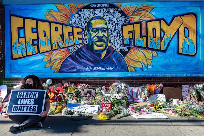 <p>Flowers, signs and balloons are left near a makeshift memorial to George Floyd near the spot where he died while in custody of the Minneapolis police, on May 29, 2020 in Minneapolis, Minnesota</p> (KEREM YUCEL/AFP via Getty Images)
