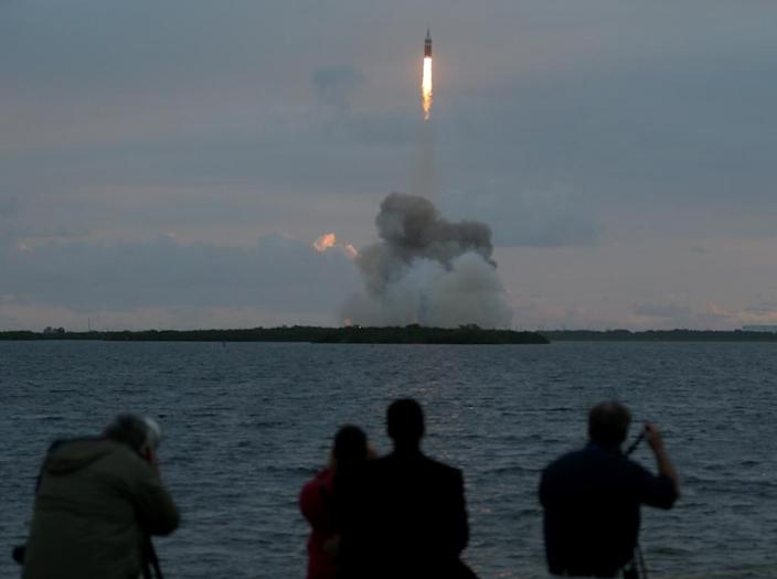 People watch a rocket take off from NASA's Cape Canaveral site (AFP Photo/Joe Raedle)