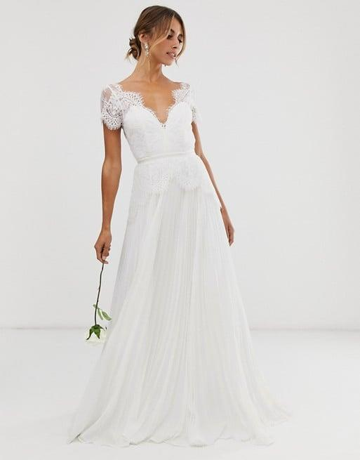 """<p>This <product href=""""https://www.asos.com/us/asos-edition/asos-edition-sophia-plunge-lace-wedding-dress-with-pleated-skirt/prd/14107765?colourwayid=16591933&amp;SearchQuery=wedding%20dress"""" target=""""_blank"""" class=""""ga-track"""" data-ga-category=""""Related"""" data-ga-label=""""https://www.asos.com/us/asos-edition/asos-edition-sophia-plunge-lace-wedding-dress-with-pleated-skirt/prd/14107765?colourwayid=16591933&amp;SearchQuery=wedding%20dress"""" data-ga-action=""""In-Line Links"""">ASOS Sophia Lace Wedding Dress</product> ($214) is selling quite fast.</p>"""