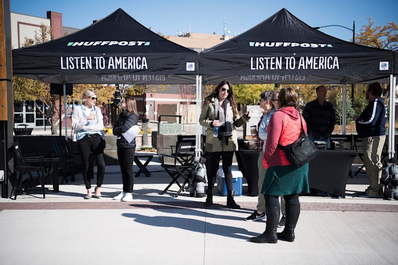 "People talk at the HuffPost tents during HuffPost's visit to Casper, Wyoming, on Oct. 13, 2017, as part of ""Listen To America: A HuffPost Road Trip."" The outlet will visit more than 20 cities on its tour across the country."
