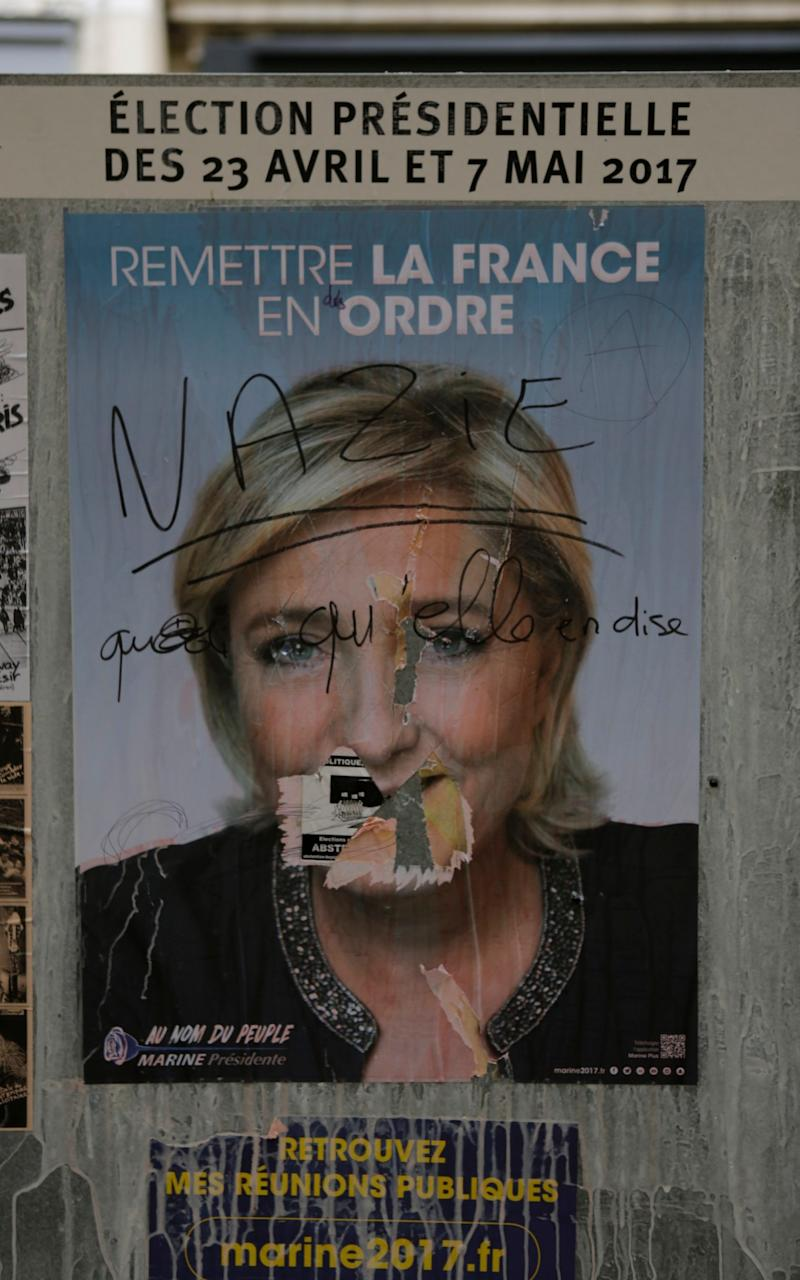 An election poster from Marine Le Pen from the Front National party has been defaced with the words 'Nazi'  - Credit: Michael Debets/Pacific/Barcroft