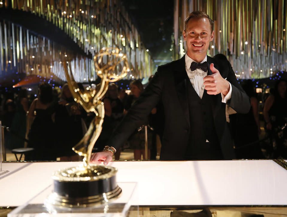 <p>A favorite of many, Alexander Skarsgård, who won Outstanding Supporting Actor in a Miniseries or a Movie for <em>Big Little Lies</em>, gave a thumbs-up from the Governors Ball. (Photo: Danny Moloshok/Invision for the Television Academy/AP Images) </p>