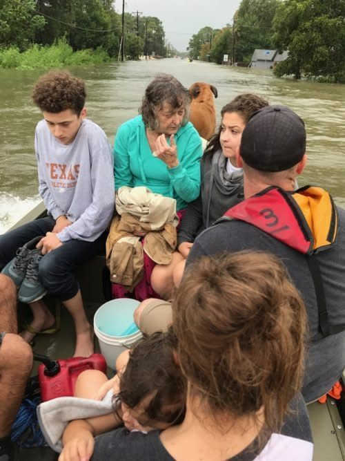 Tim Miller's granddaughter Natalie (front right), with other members of herfamily and Odie Walder, boating to safety in the aftermath of Harvey. (Tim Miller/Texas EquuSearch)