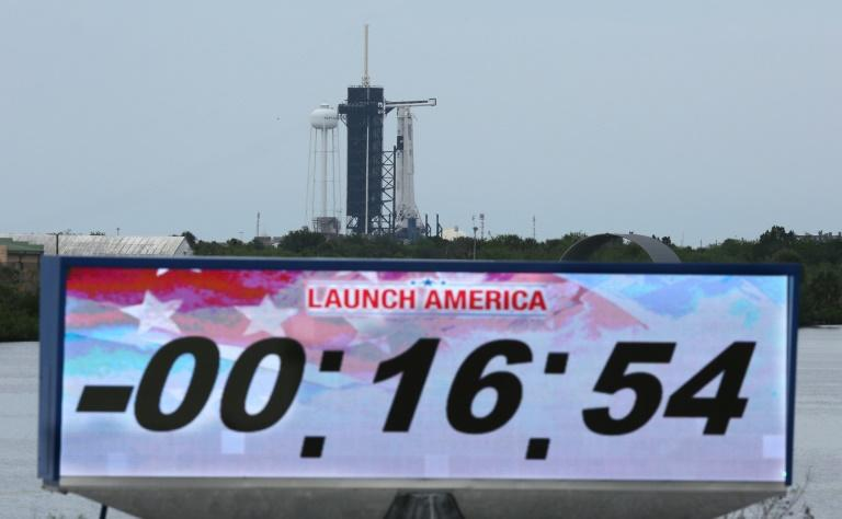 The countdown clock is stopped after the launch of the SpaceX Falcon 9 rocket carrying the Crew Dragon spacecraft was scrubbed at Kennedy Space Center
