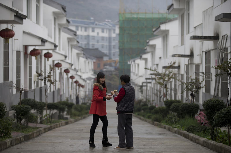 Chinese villagers move in from the country