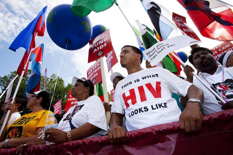 Marco Benjamin, 32, of New Brunswick, N.J., second from right, who is HIV positive, walks in the AIDS March in Washington, Sunday, July 22, 2012. (AP Photo/Jacquelyn Martin)