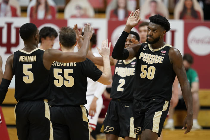 Purdue's Trevion Williams (50) celebrates with Brandon Newman (5) after Williams hit a shot and was fouled during the second half of the team's NCAA college basketball game against Indiana, Thursday, Jan. 14, 2021, in Bloomington Ind. Purdue won 81-69. (AP Photo/Darron Cummings)