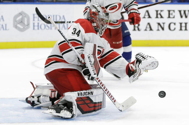 Carolina Hurricanes goaltender Petr Mrazek (34) can't hang onto a shot by the Tampa Bay Lightning during the second period of an NHL hockey game Tuesday, Oct. 16, 2018, in Tampa, Fla. (AP Photo/Chris O'Meara)