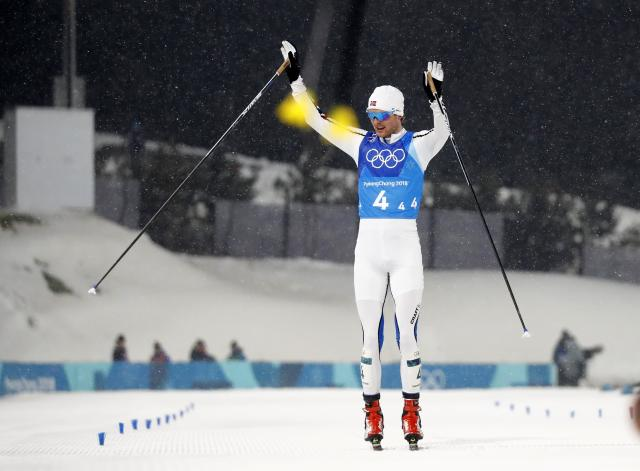 Nordic Combined Events - Pyeongchang 2018 Winter Olympics - Men's Team 4 x 5 km Final - Alpensia Cross-Country Skiing Centre - Pyeongchang, South Korea - February 22, 2018 - Joergen Graabak of Norway celebrates. REUTERS/Kai Pfaffenbach