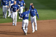 Toronto Blue Jays' Teoscar Hernández, right, celebrates with Danny Jansen after hitting a walk-off two-run single against the Baltimore Orioles during the ninth inning of a baseball game in Buffalo, N.Y., Sunday, Aug. 30, 2020. Toronto beat Baltimore 6-5. (AP Photo/Adrian Kraus)