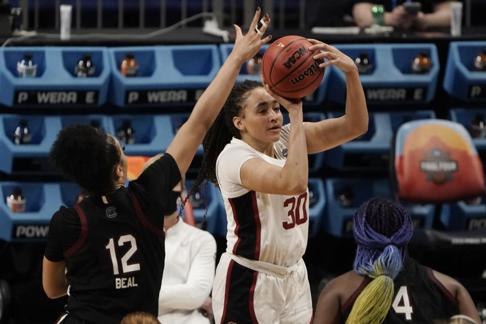 Stanford guard Haley Jones (30) shoots over South Carolina guard Brea Beal (12) during the second half of a women's Final Four NCAA college basketball tournament semifinal game Friday, April 2, 2021, at the Alamodome in San Antonio. (AP Photo/Morry Gash)