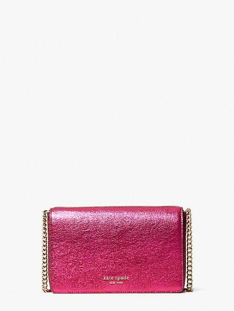 <p>Does she love sparkles? Go for this <span>Kate Spade New York Spencer Metallic Chain Wallet</span> ($188).</p>