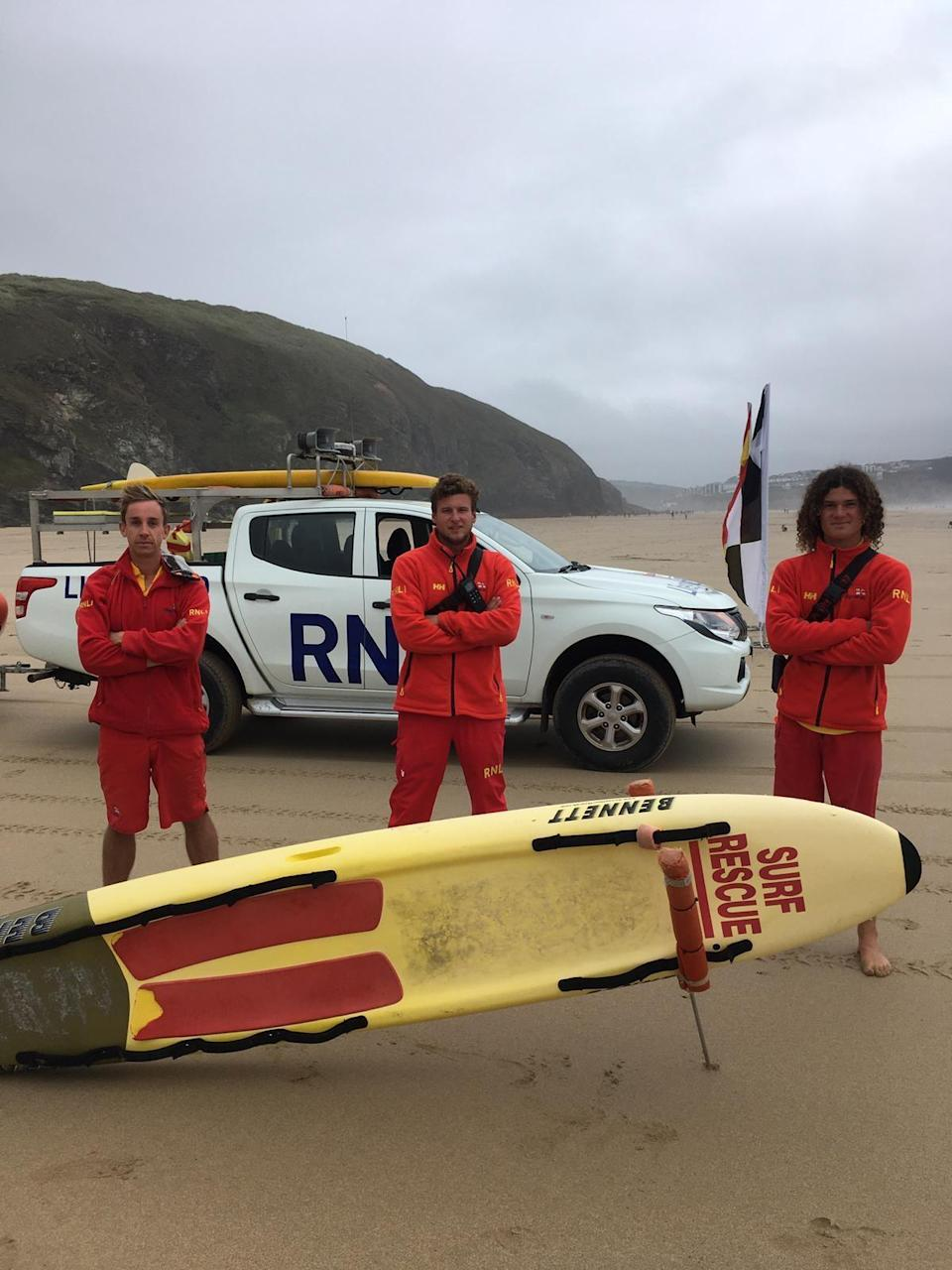 Lifeguards Tomo Harder, Charley Florey and Ben Evans after Saturday's rescue (RNLI/PA)