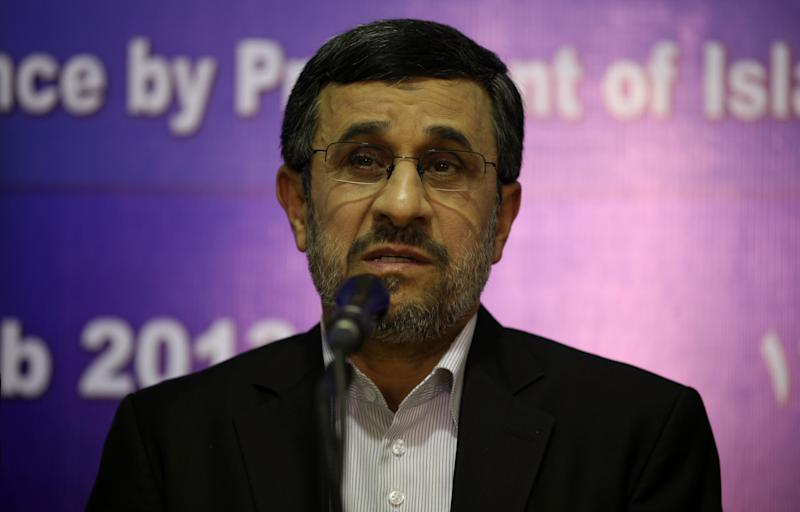 "Iran's President Mahmoud Ahmadinejad speaks to the media during a press conference in Cairo, Egypt, Thursday, Feb. 7, 2013. Iranian President Mahmoud Ahmadenijad is trying to entice Egypt into a new and powerful axis that could reshape the turbulent Middle East, speaking of forging ""comprehensive"" and ""unfettered"" relations after decades of distrust. A warming of ties could have uncomfortable repercussions for the U.S. and its wealthy Gulf allies, giving Iran a foothold to spread its influence in Egypt. In turn, Egypt could gain an avenue to influence the fate of Syria, a key ally of Iran, as well as economic benefits. (AP Photo/Khalil Hamra)"