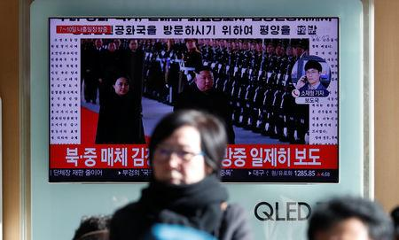 People watch a TV broadcasting a news report on North Korean leader Kim Jong Un's visit to China, in Seoul, South Korea, January 8, 2019    REUTERS/Kim Hong-Ji