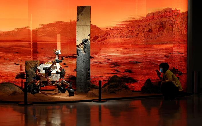 An exhibition depicting a rover in Mars in Beijing - AP