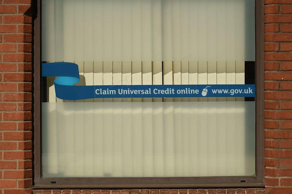 The cut will mean Universal Credit claiments no longer recieve a £20-a-week uplift  (AFP via Getty Images)