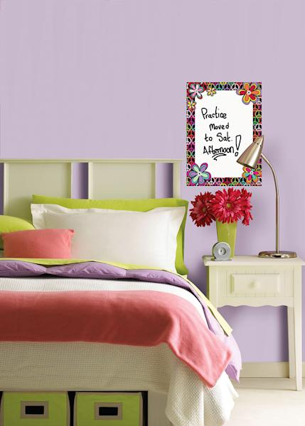 This publicity photo provided by courtesy of Brewster Home Fashions shows the WallPops Peace Dry-Erase Message Board decal that can help a student keep track of appointments or a bedtime checklist of responsibilities. (AP Photo/Brewster Home Fashions)