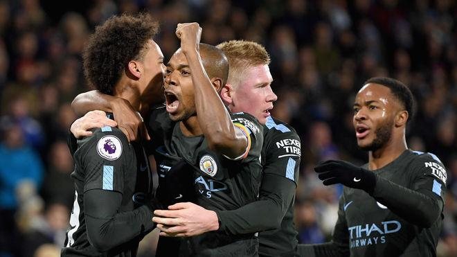 HUDDERSFIELD, ENGLAND - NOVEMBER 26: Leroy Sane celebrates with Fernandinho, Kevin De Bruyne and Raheem Sterling of Manchester City after winning the Premier League match between Huddersfield Town and Manchester City at John Smith's Stadium on November 26, 2017 in Huddersfield, England. (Photo by Shaun Botterill/Getty Images)