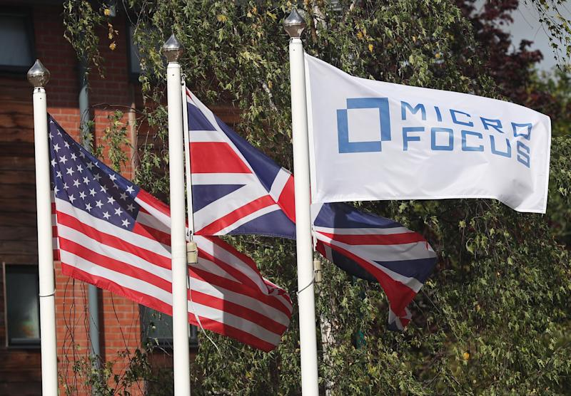 Flags fly outside the offices of Micro Focus after they and Hewlett Packard Enterprise Co announced that Hewlett Packard Enterprise Co will spin off and merge its non-core software assets with Britain's Micro Focus International in a deal worth $8.8 billion, in Newbury, Britain, September 8, 2016. REUTERS/Eddie Keogh