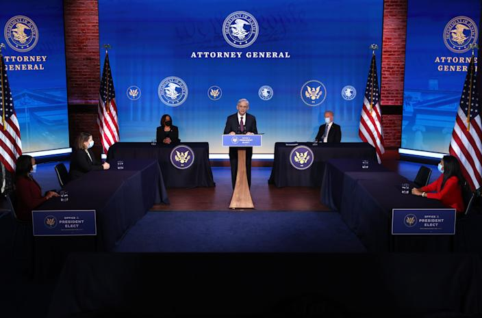 Federal Judge Merrick Garland (C) delivers remarks after being nominated to be U.S. attorney general by President-elect Joe Biden (R) at The Queen theater Jan. 7, 2021 in Wilmington, Delaware.