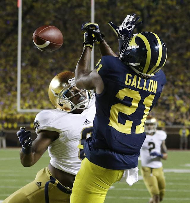 Notre Dame cornerback KeiVarae Russell (6) deflects a pass intended for Michigan wide receiver Jeremy Gallon (21) during the second quarter of an NCAA college football game in Ann Arbor, Mich., Saturday, Sept. 7, 2013. (AP Photo/Carlos Osorio)