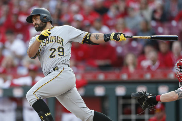 FILE - In this March 28, 2019, file photo, Pittsburgh Pirates' Francisco Cervelli hits a single off Cincinnati Reds relief pitcher Jared Hughes in the sixth inning of a baseball game in Cincinnati. The Pirates are parting ways with veteran catcher Francisco Cervelli, who has been hampered by multiple concussions this season. The club announced Thursday, Aug. 22, 2019, it requested unconditional release waivers for the 33-year-old Cervelli. (AP Photo/Gary Landers)