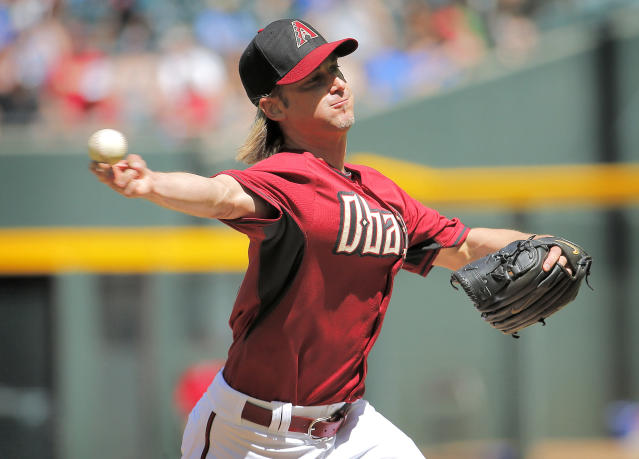Arizona Diamondbacks pitcher Bronson Arroyo throws during the first inning of an exhibition spring training baseball game against the Chicago Cubs, Saturday, March 29, 2014, in Phoenix. (AP Photo/Matt York)