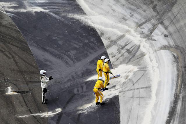 BRISTOL, TN - MARCH 18: Safety crew members clean up after an on track incident during the NASCAR Sprint Cup Series Food City 500 at Bristol Motor Speedway on March 18, 2012 in Bristol, Tennessee. (Photo by Chris Trotman/Getty Images)