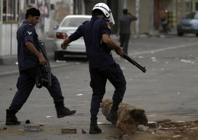 Riot police clear the way during clashes with Bahraini anti-government protesters Wednesday, June 20, 2012, in Malkiya village, Bahrain. Clashes erupted after riot police fired tear gas to disperse people gathering for a march in support of political prisoners. (AP Photo/Hasan Jamali)