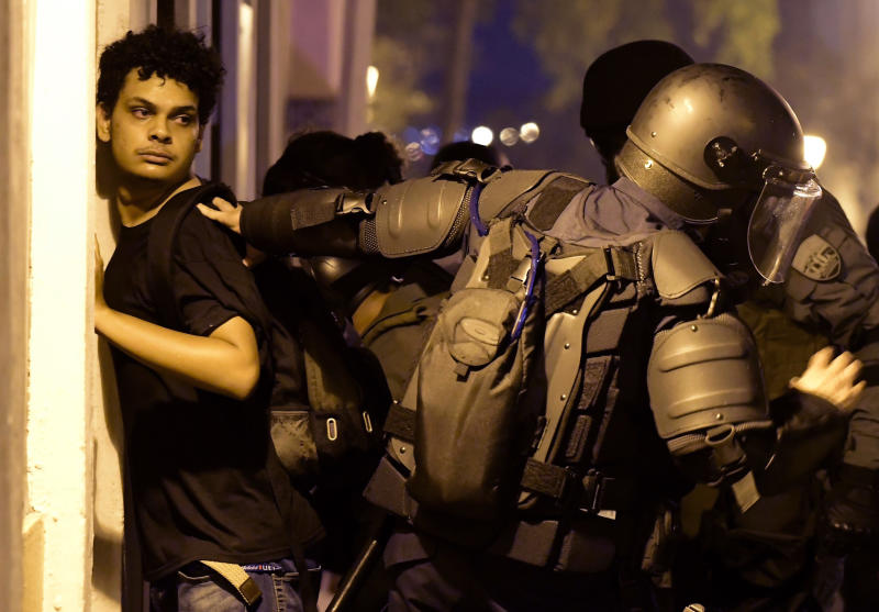 Police arrest a demonstrator during clashes near the executive mansion demanding the resignation of Gov. Ricardo Rossello, in San Juan, Puerto Rico, Wednesday, July 17, 2019. (Photo: Carlos Giusti/AP)