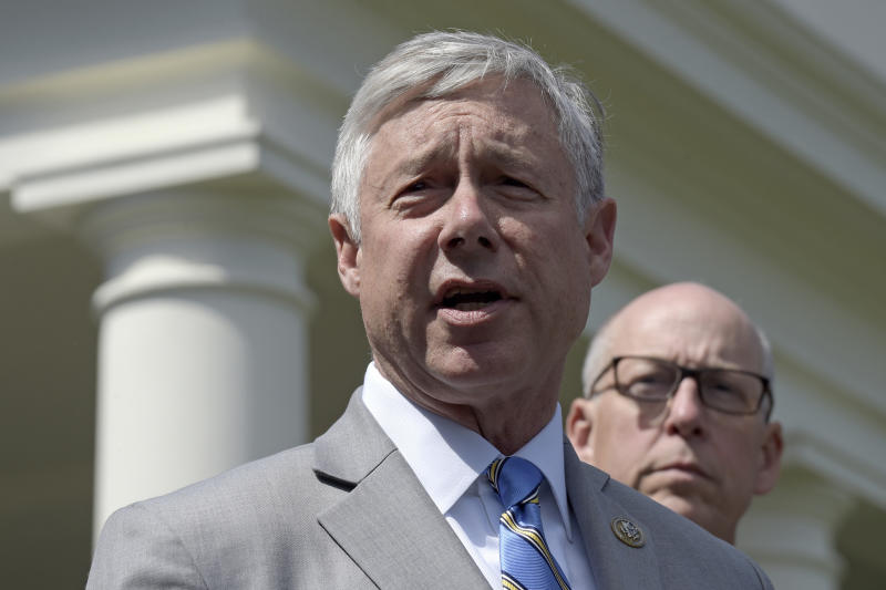 "FILE - In this May 3, 2017, file photo, Rep. Fred Upton, R-Mich., left, speaks to reporters outside the White House in Washington. Upton, said he doesn't support a formal impeachment inquiry against President Donald Trump. But he has no problem with Democratic-led committees digging for more information. Upton told the Detroit Economic Club that ""we need to know what the answers are."" He shared the stage Wednesday, Oct. 2, 2019 with Democratic Rep. Debbie Dingell. (AP Photo/Susan Walsh, File)"
