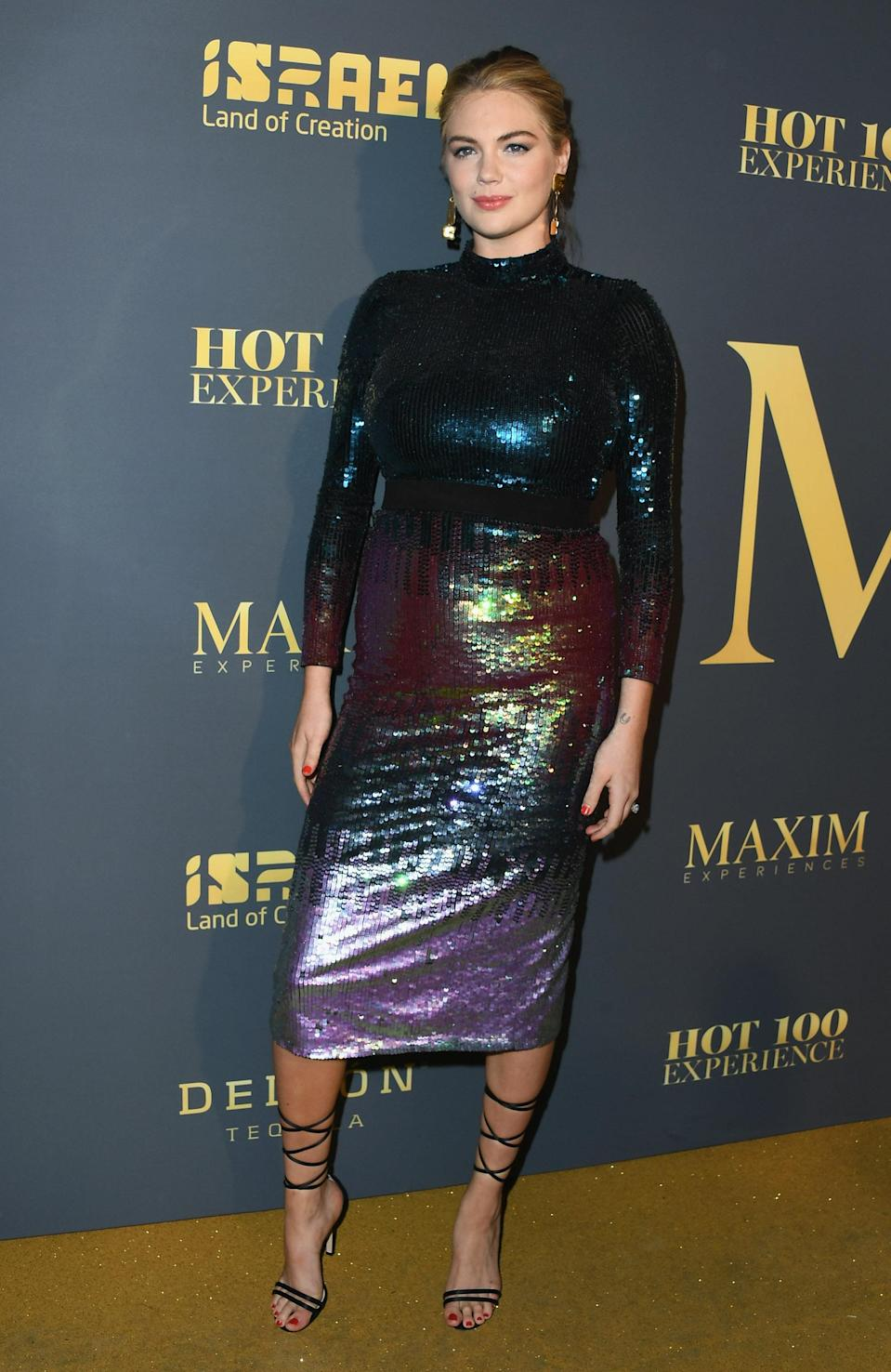 <p>The model and actress worked a sequin dress by London Fashion Week designer Temperley. <em>[Photo: Getty]</em> </p>