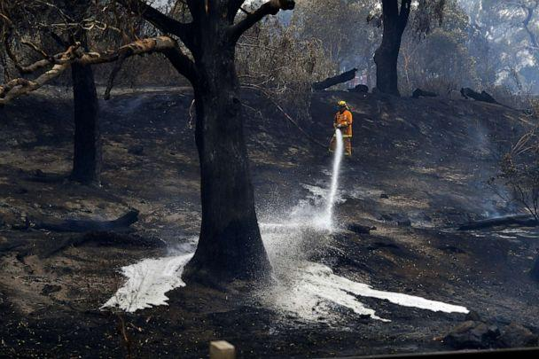 PHOTO: A CFA firefighter is seen as a fire hit Clovemont Way in Bundoora outside Melbourne,Dec. 30, 2019. (AAP Images via AP)