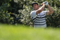 Bryson DeChambeau watches his tee shot on the 14th hole during the third round of the Wells Fargo Championship golf tournament at Quail Hollow, Saturday, May 8, 2021, in Charlotte, N.C. (AP Photo/Jacob Kupferman)