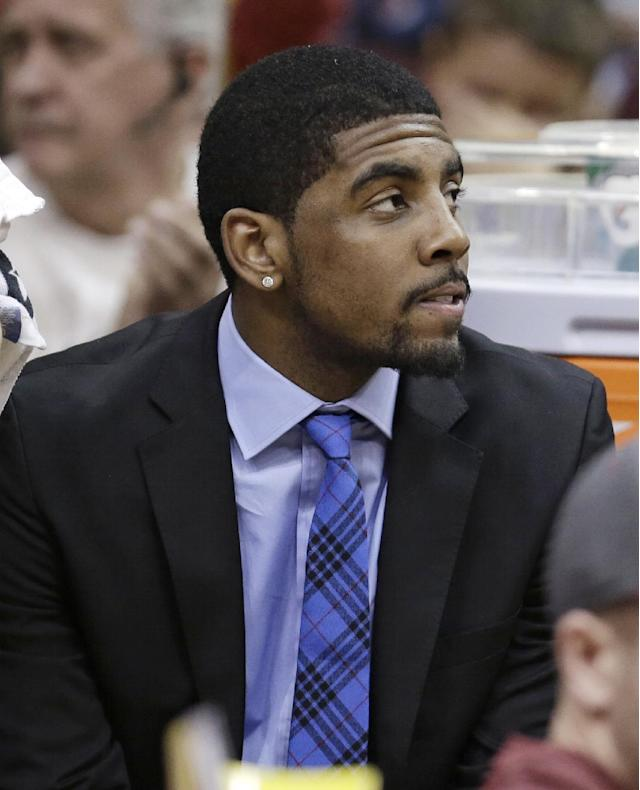 Cleveland Cavaliers' Kyrie Irving watches during the fourth quarter of an NBA basketball game against the Orlando Magic Thursday, Jan. 2, 2014, in Cleveland. Irving missed his first game this season because of a bruised left knee.The Cavaliers won 87-81. (AP Photo/Tony Dejak)