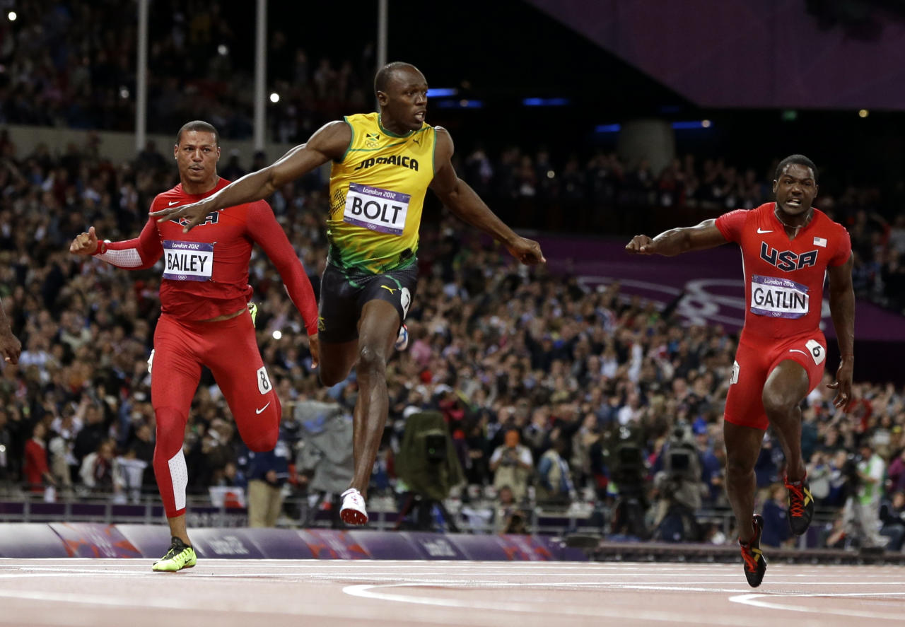 Jamaica's Usain Bolt, center, leads in the men's 100-meter final during the athletics in the Olympic Stadium at the 2012 Summer Olympics, London, Sunday, Aug. 5, 2012. (AP Photo/Anja Niedringhaus)