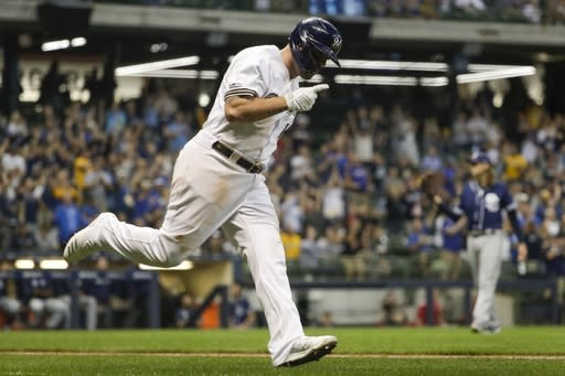 Milwaukee Brewers' Mike Moustakas celebrates his home run during the seventh inning of a baseball game against the San Diego Padres Tuesday, Sept. 17, 2019, in Milwaukee. (AP Photo/Morry Gash)