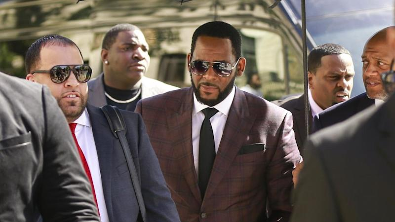 Singer R. Kelly (C) has pleaded not guilty to sex trafficking and racketeering charges in New York