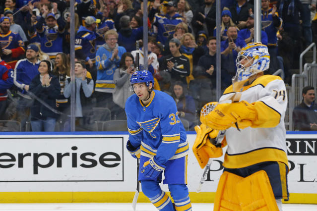St. Louis Blues' Jordan Kyrou, middle, skates to his bench after scoring a goal against Nashville Predators goaltender Juuse Saros, of Finland, during the second period of an NHL hockey game Saturday, Feb. 15, 2020, in St. Louis. (AP Photo/Billy Hurst)