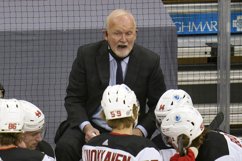 New Jersey Devils coach Lindy Ruff gives instructions during the first period of the team's NHL hockey game against the Pittsburgh Penguins in Pittsburgh, Thursday, April 22, 2021. (AP Photo/Gene J. Puskar)
